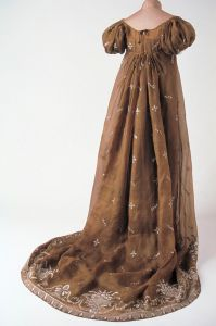 """6.Empire Gown Robe Empire French, about 1800–1810 Muslin, flat stitch embroidery, point lance (""""thrown stitch""""), point de tige (""""stem stitch""""), spangles, and appliqués of tulle and crepe muslin 130 x 170.2 cm (51 x 67in.) *Musée des Tissus et des Arts Décoratifs, Lyon (MT 29800) *Courtesy of the American Federation of Arts"""